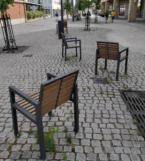 14. Differently facing park benches